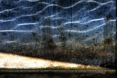 Water Ripples (Galen Lockwood) Tags: blue light sun snow reflection texture water dark mud cement dirty drain ripples hdr cracked eery shimmer wasting mirky