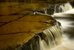 (Northumbria Photography) Tags: longexposure england water canon geotagged rocks northumberland bellingham cascade 18200mm canoneos400d canon18200mmis geo:lat=55158977 geo:lon=2251285