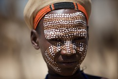 Dotted face (ingetje tadros) Tags: africa travel boy portrait face rural painting community close desert body embroidery african south young culture streetphotography makeup jewelry tribal bodypaint adventure passion ethiopia dots ethnic bodyart tribo 2010 ethiopian omo thiopien etiopia ethiopie etiopa  etiopija ethnie ethiopi  etiopien tribel etipia travelphotographer  etiyopya    arboretribe       weytovalley ingetjetadros