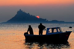 "Perfect Evening - A local lobster boat returns to Marazion just as the sun sets behind the Mount. This is  an image from my recent archives as my arthritis and the rain have stopped me going out for a while!  This image looks a lot better if you please <a href=""http://bighugelabs.com/onblack.php?id=4474498148&size=large"" rel=""nofollow"">View On Black</a>"