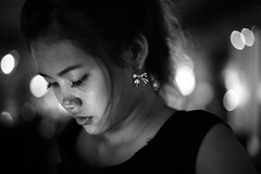 Sweet surrender.... (N A Y E E M) Tags: nightphotography portrait girl monochrome bar digital thailand outdoors sweet availablelight bangkok candid waitress sasi frontdoor surrender hotelintercontinental chitlom canonef50mmf14usm canoneos5d fbar nayeemkalam