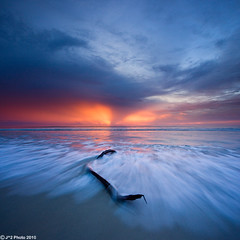 Tornado Sunset (J.^2) Tags: sunset sea sky seascape blur tree eye water clouds flow heaven branch dusk wing wave explore malaysia borneo tornado frontpage sabah kudat tipofborneo sulusea vertorama kalampunianbeach