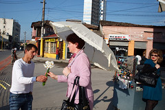Flowers - Tirana, Albania (Maciej Dakowicz) Tags: city morning people flower lady umbrella person europe capital lipstick balkans dailylife albania seller tirana