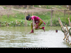 Jump (Shabbir Ferdous) Tags: wet water girl droplets jump photographer shot action teen dhaka bangladesh bangladeshi turag ef70200mm28lisusm shabbirferdous canoneos1dmarkiv wwwshabbirferdouscom shabbirferdouscom