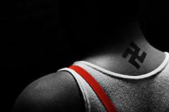 Skinhead (Gabby Baginski) Tags: tattoo hair beard cross cigarette smoke nazi swastika celtic suspenders skinhead
