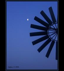 "Half. (Picture post.) Tags: morning blue sky moon abstract black windmill silhouette half soe blades morningsky onblue blueribbonwinner otw mywinners abigfave platinumphoto ""flickraward"" superstarthebest"