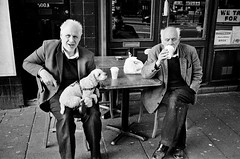 Old twins and their pet lamb (?) (deepstoat) Tags: street bw dog london film monochrome zeiss 35mm twins snap similar uncanny contaxt3 identical deepstoat
