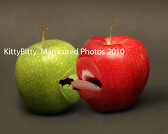 Apple Exception (KittyBitty: Manicured Photos) Tags: red green apple strange tongue fruit photomanipulation photoshop mouth weird kiss different teeth kitty australia melbourne lips biting pash bite mouthes grannysmith contrasts bizarre isolated individuality bitty manicured redapple reddelicious galaapple isolatedonblack kittybitty1 kittybitty manicuredphotos