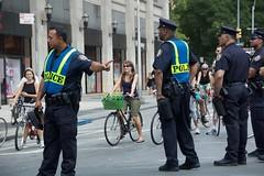 NYPD officers  on Lafayette Street during Summer Streets. (jackszwergoldarchives) Tags: manhattan newyorkcity summerstreets szwergold