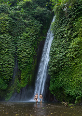 Tourists having a bath in Munduk waterfall, Bali island, Munduk, Indonesia (Eric Lafforgue) Tags: adults asia bali bali1442 balinese bath cascade cascades cataract cataracts countryside day daylight east exteriors falls flow flowing flows green indonesia indonesian landscape landscapes menonly munduk nature outdoors stream streaming streams tourism tourists twopeople vertical water waterfall waterfalls waters baliisland