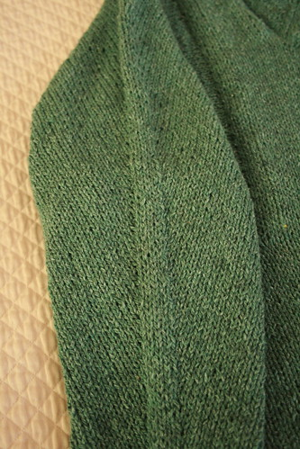 green sweater sleeve