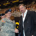 Spec. David Hutchinson (left) of the Army Reserve's 420th Engineering Brigade in Bryan, Texas, shakes hands with American Country Music Artist Darryl Worley, before the start of the U.S. Army All American Bowl game at the Alamodome here Jan. 9.