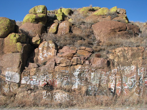 Graffiti-covered granite at the eastern end of the old US 62 bridge over the North Fork Red River