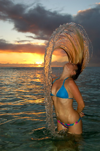 A girl flipping her wet hair in a twirl