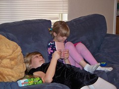 Emily and her friend play DS (abbamouse) Tags: girls playing kids emily play nintendo ds games couch 2010