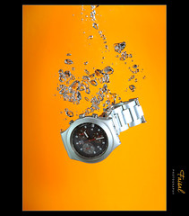 14:32 (Faisal | Photography) Tags: orange speed silver photography swatch high watch bubbles explore splash fp canonef2470mmf28lusm 2010 canoneos50d canonspeedlitetransmitterste2 canonspeedlite580exii faisal|photography