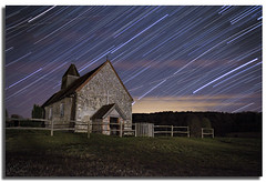 Church By Night Star Trails (Aaron_Bennett) Tags: uk trees art church night stars photography glow cross earth explore planes frontpage startrails sthubert idsworth aaronbennett nikond300