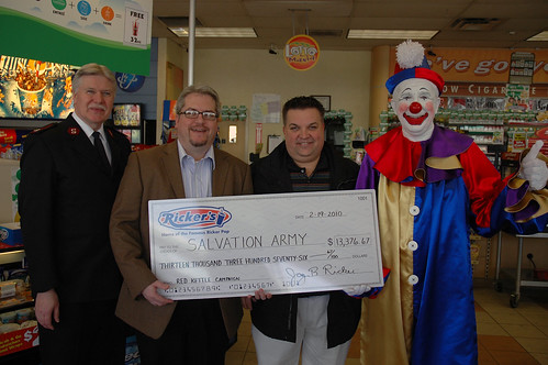 (from left to right) Major Keith Welch and Jeff Stanger of The Salvation Army except a check from Mike Jones and Jay Ricker of Rickers AM/PM stores.