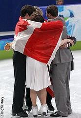 Group hug for training partners Virtue/Moir and Davis/White. (Photo by Liz Chastney