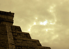 chichn itz -  kukulcan ascends (Xuan Che) Tags: travel winter light sky history archaeology yellow architecture clouds photoshop mexico temple ancient ruins december pyramid maya yucatan 2006 chichenitza gods canonixus400 quetzalcoatl worldheritage kukulcan prehispanic elcastillo featheredserpent