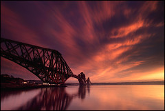 Forth Rail Bridge @ Sunset (angus clyne) Tags: road bridge blue sunset red sea sky orange sun ferry river gold coast scotland edinburgh track fife angus north bridges scottish bank rail railway calm east queens forth shore hour firth gloaming forthrailbridge clyne flikcr leefilters colorphotoaward impressedbeauty