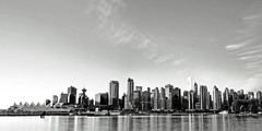 Name that Building (Christopher J. Morley) Tags: longexposure morning blackandwhite bw white canada black vancouver sunrise downtown stanleypark lastyear theseawall beautifulbritishcolumbia takenfrom 10second anytimeofday twoshotpano igrewtolove beingonorbelow