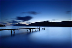 Fading into Blue (angus clyne) Tags: world wood longexposure travel blue sunset cloud mountains green art beach nature water way island star march scotland pier boat highlands dock post wind very harbour fort walk north dream deep scottish peak bank windy william calm glen dreaming hills beam pile shore stary docked relaxed setting westcoast slope gloaming winterspring veryblue pland bluer outoftheordinary tobluetobetrue angusclyne surrealstrangeweirdbizarre