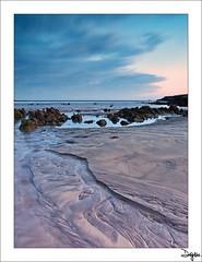 Ro de Arena (diegogm.es) Tags: sunset sea espaa seascape beach marina mar spain sand agua asturias playa gozon olympus arena puestadesol zuiko roca oceano piedra cantabrico 1442 pedreo baugues e520