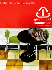 Give it back. (asvirskas) Tags: man green hat wall ads table bottle chair nap break ad coke ne tiles commercial tired rest soda cocacola recycle recycling sustainable barstool eatery cantine tiled chequered taip ne6 ne4 ne5 ne10 ne8 ne9 ne3 ne7 taip2 taip5 taip3 taip4
