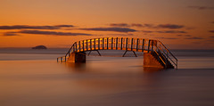 Bridge to Nowhere (ajnabeee) Tags: longexposure bridge sunset orange seascape motion blur yellow clouds scotland perfect glow dusk tide nowhere filter dunbar northberwick lothian firthofforth bassrock belhavenbay 10stop nd1000 nd10 shahbazmajeed