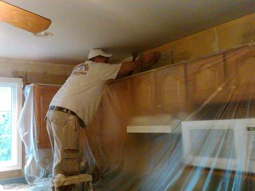 Olger Fallas Painting Stripping Wall Paper at ...