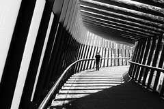 There's light at the end of the tunnel (The Green Album) Tags: shadow bw sunlight geometric lines bristol walking person circus curves walkway carpark solitary futuristic cabots platinumphoto superaplus aplusphoto theunforgettablepictures