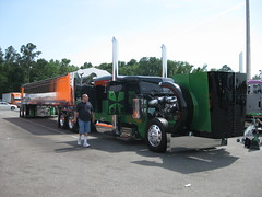 75 Chrome Shop - 12th Annual Truck Show - 2010 (FormerWMDriver) Tags: auto show tractor black green shop truck big shiny display wheels semi clean stop bumper chrome commercial rig trucks interstate trailer custom rim wildwood rims 75 i75 polished stacks peterbilt bumpers widowmaker chromeshop cleanslateenvironmental 2004peterbilt379 2010macdumptrailer