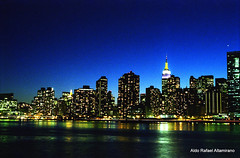 New York at night (Rafakoy) Tags: camera city longexposure blue sky newyork color colour reflection building film water colors skyline night 35mm buildings reflections 50mm gold lights long exposure cityscape colours kodak nikonf100 queens 200 epson v600 longislandcity perfection ligh kodakgold200 epsonv600 epsonperfectionv600 aldorafaelaltamirano rafaelaltamirano aldoraltamirano