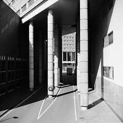 Harsh Lines (Alex !) Tags: city sun white black building 120 film monochrome lines architecture square blackwhite lomo shadows bright 120film lubitel2 lubitel 100 groningen pillars offices harsh asa100 foma 75mm grunn fomapan t22 snaptweet