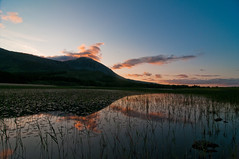 Cillchroist (tanera) Tags: blue cold skye water silhouette clouds reflections reeds weeds waves isleofskye shoreline bluesky reflective loch cuillins rushes broadford crepuscular wavelet