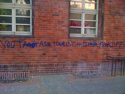 Graffiti: You Fagot Ass Tourist Hipster Fuck Off!