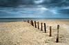 "beach stakes (D.Reichardt) Tags: longexposure beach lines clouds landscape denmark europe northsea stakes piles römö ""flickraward"""