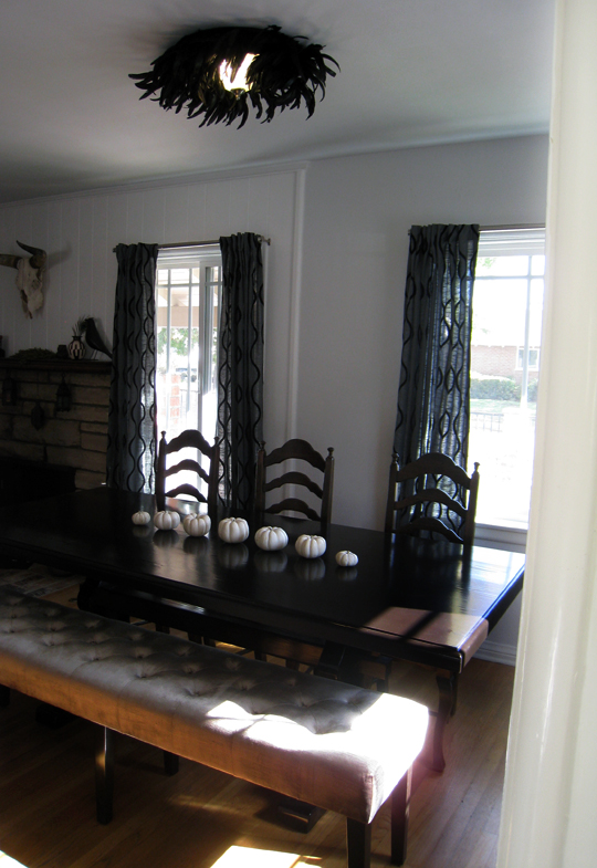 dining room+table and bench+feather light+white pumpkins+cow skull