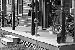 244_Market St Porch_2b (jannetie) Tags: trees blackandwhite cats newyork tractor art clock bicycle architecture contrast photoshop manipulated reflections golf ir 3d village furniture flag photoshopped bricks banner broadway victorian gourmet infrared trucks antiques storefronts ferns drugstore redhook golfcart retouching contrasts retouched houseplants dutchesscounty chromadepth gazingball porches gazingglobe fauxinfrared