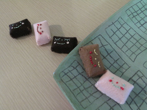 Miniature felt candy that I sewed by hand.