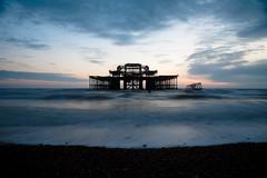 the demise of the west pier (lomokev) Tags: sea sky cloud beach clouds canon eos pier brighton dusk westpier 5d canoneos5d deletetag file:name=100216eos5d4120 longexspsure