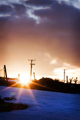 It's A Beautiful Day (Michelle in Ireland) Tags: light sunset snow clouds star scotland aberdeen rays telephonepole beams