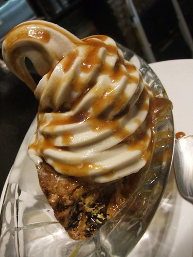 vegan 'm&ms' blondie with cakebatter softserve and caramel sauce.