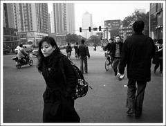 passerby (-{ thus }-) Tags: china street winter people blackandwhite bw woman monochrome bike digital crossing nanjing ricoh 2009  grd3 thusihaveseen grdiii