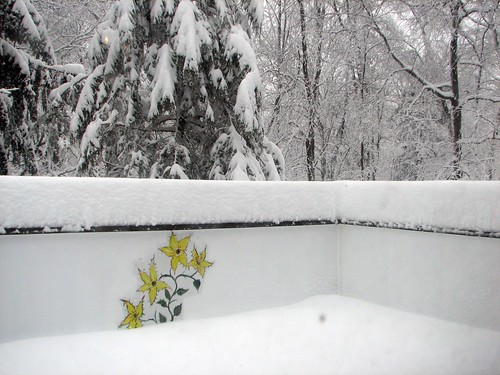 deck mural peeks out of the snow