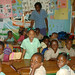Roxanne, a teacher at Bigwoods School, with her class of 3's and 4's