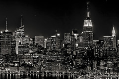 the lights of new york city (mudpig) Tags: nyc newyorkcity longexposure sunset bw white newyork black building monochrome skyline night skyscraper geotagged cityscape nightscape esb empirestate chryslerbuilding mudpig stevekelley