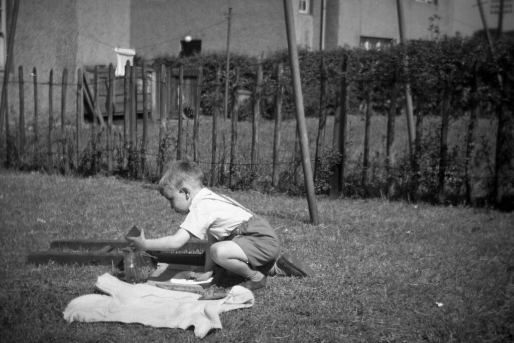 Ian Ross ? born 1955 plying outside family home in Kirkintilloch, 1958.