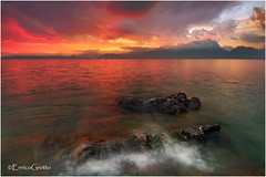 Garda Red Passion, Garda Lake - Italy (Enrico Grotto) Tags: longexposure sunset italy mountain lake color reflections landscape lago nikon san garda soft italia tramonto nuvole 09 cielo lee neve punta nikkor grad acqua rosso colori riflessi alpi montagna luce paesaggio vanguard 1224 torri onda benaco sirene baia filtro gnd pizzocco d40 wondersofnature cluod vigilio capturenature grottoenrico